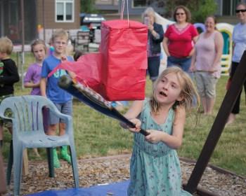 alaina whacking pinata with baseball bat