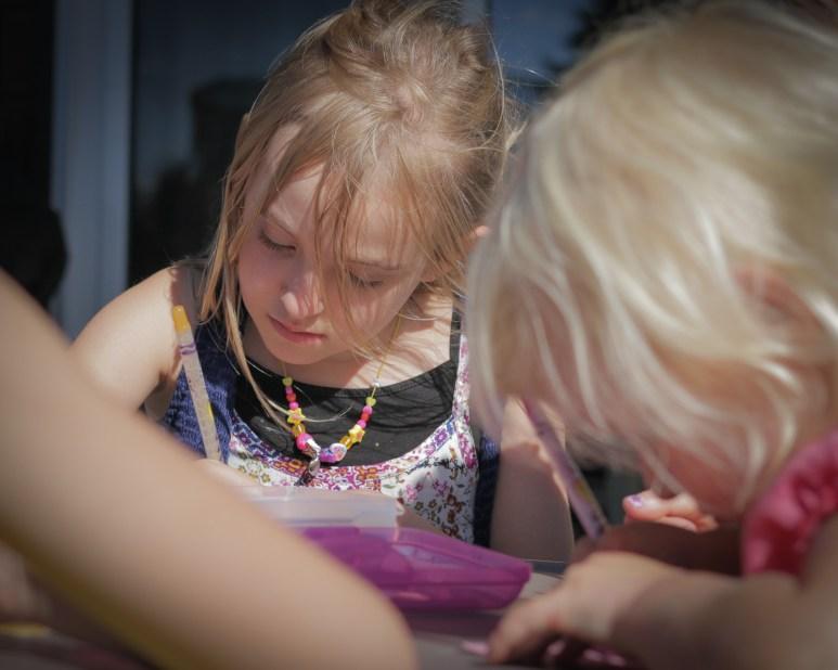 kids drawing outside