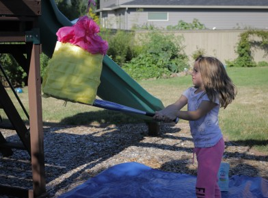 girl smashing pinata