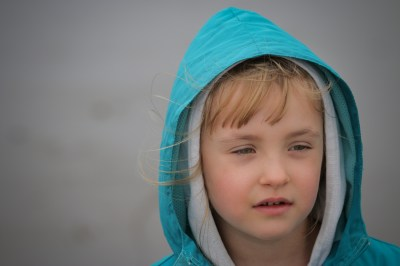 little girl with turquoise hood