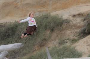 little girl flying