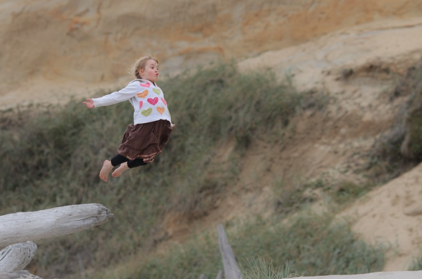 little girl flying