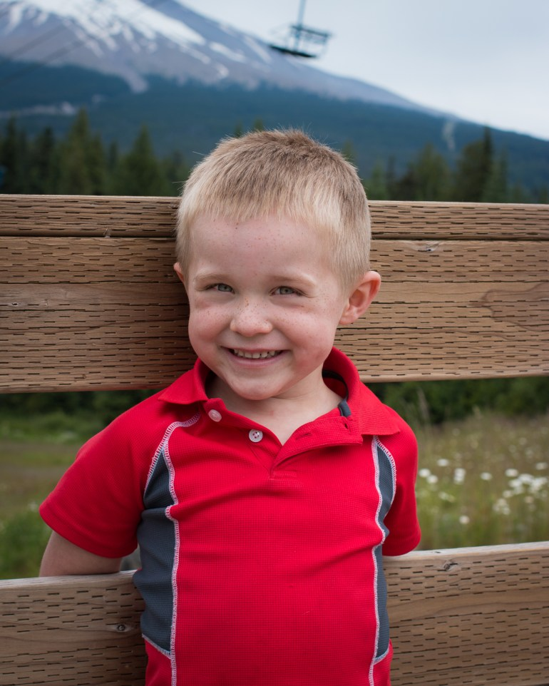 little boy in red shirt smiling