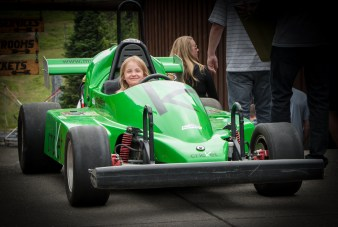 alaina in green race car