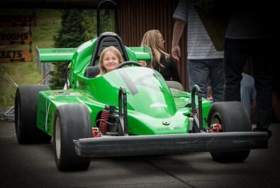 alaina in green race car