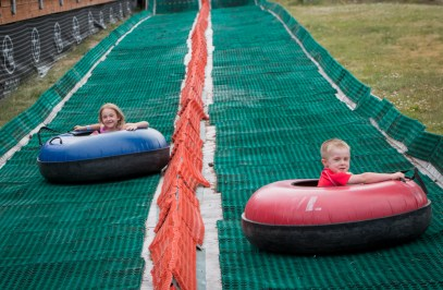 brother and sister on tubes