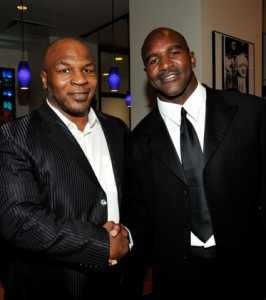 wi-boxers-mike-tyson-and-evander-holyfield-pose-backduring-the-17th-annual-espy-awards-266x300