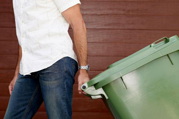 man-taking-the-garbage-out