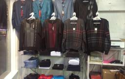 Simple site for small store. Clothes on a display rack are shown.
