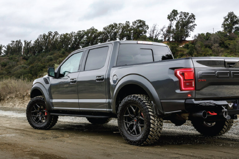 gray ford truck on dirt road