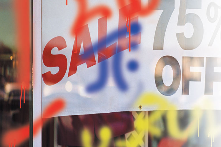 blue and red graffiti on store window