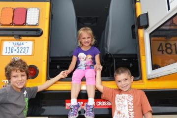 Comal ISD children sitting at back of school bus