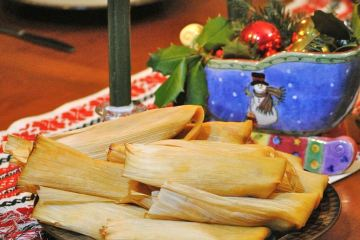 Plate of tamales with Christmas decorations in background