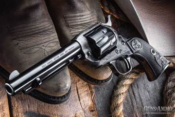 Single-action colt sitting on cowboy boots