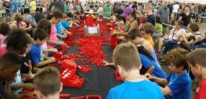 Kids building with the 20,000 LEGO bricks in a free build area. It is amazing what they create from their imaginations. (photo by Bryan Bonahoom)