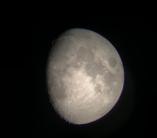 Image of the moon shot through a telescope with an iPhone.