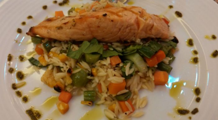 The Salmon Catch dish at Maple. It can be grilled, pan-seared, or blackened and comes with orzo pasta and Texas summer veggies.