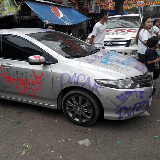 One of the cars trashed during the Sinulog. (Photo by Mike Limpag)