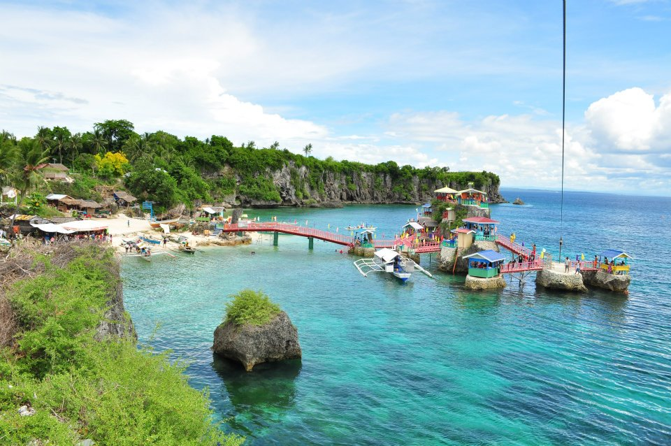 Swim in blue seas, zip or dive from a cliff in Funtastic Island Medellin