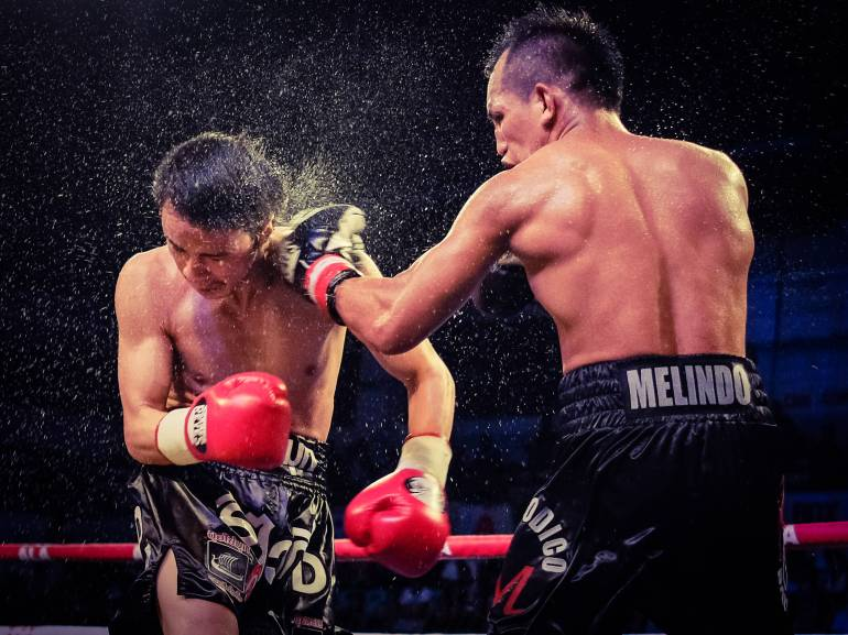 DODGE THIS. Milan Melindo's left jab connect to Sakkreerin's head. (Photo by Albert Flores)