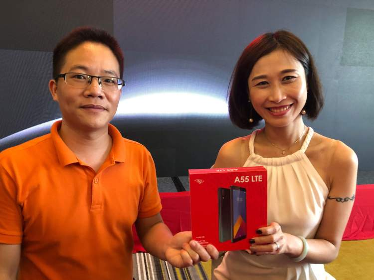 CURRENT FLAGSHIP. Itel Sales Manager Star Luo (left) and Head of Southeast Asia Rachel Wei hold the itel A55, the company's current flagship device. It has a 6-inch IPS screen, octacore 1.6Ghz processor with 2GB of RAM, 16GB of storage that is upgradeable, and Android 9. The unit sells for P3,600.