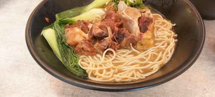 OXTAIL RAMEN. This dish has oxtail meat simmered for 6 hours to bring out the tenderness and flavor. It is served with shiitake mushrooms, bok choi, and green onions over Hakata-style noodles.