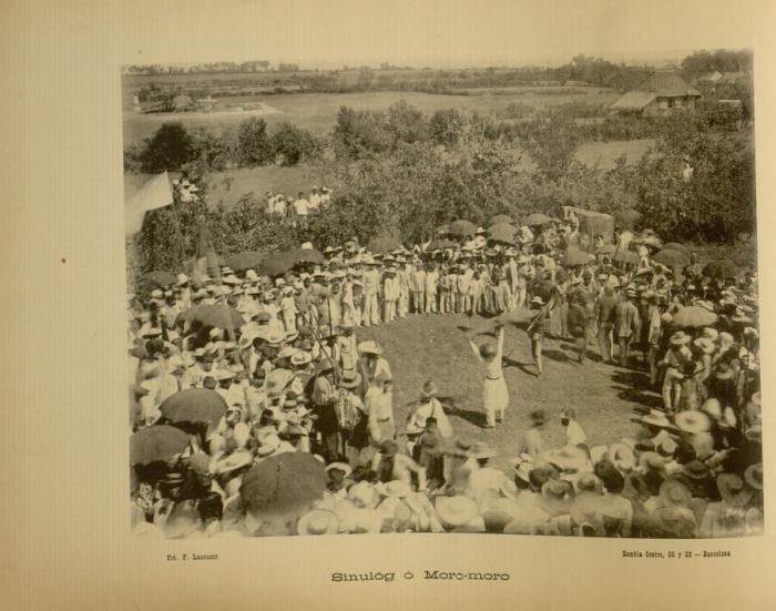 "SINULOG AS WAR DANCE. This photograph is of a sinulog or moro-moro performed in Jaro, Iloilo. It appears ""Recuerdos de Filipinas"" by Felix Lauereano that was published in 1895. Sinulog is mentioned as a fiesta dance in Panay island with roots in Jolo."