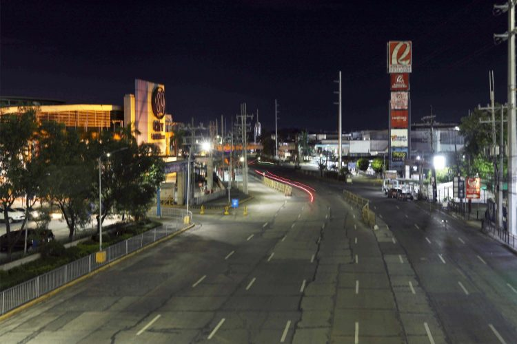 EMPTY STREETS. The Quirino Highway in Fairview, Quezon City is deserted in this photo taken on March 17, 2020. An enhanced community quarantine was imposed in Metro Manila to curb the spread of the coronavirus. (PNA photo by Oliver Marquez)