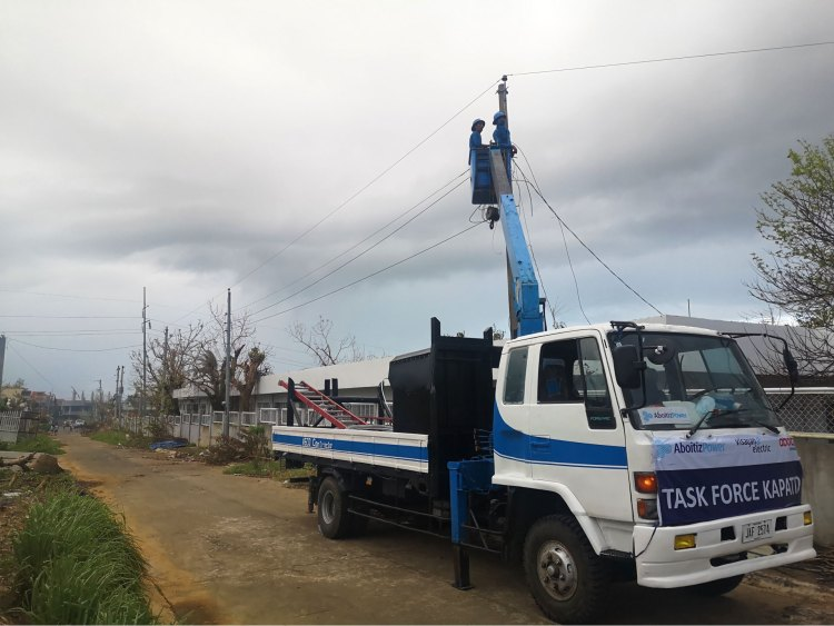 Linemen from the Visayan Electric Co. conduct line stringing works on one of the affected electric poles in Tiwi, Albay on Saturday, Nov. 14, 2020.