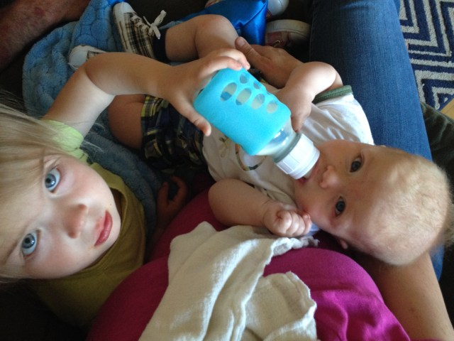 Stella loves to help feed Harvey his bottle :)