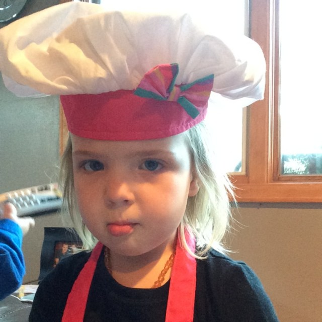 Post-puke #1, pre-puke #2. Practicing her fish face while wearing her chef hat. :)