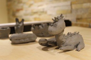 Tiny clay creations await to be fired or glazed, and go home with their creators!