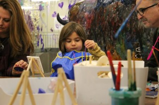 Paint to your heart's content on canvas, or on a giant glass wall in the Art Studio!
