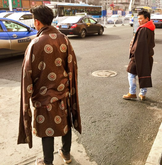 Tibetan men with traditional Tibetan jackets