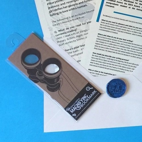 A fun spy glass magnifying bookmark Nov 17 box