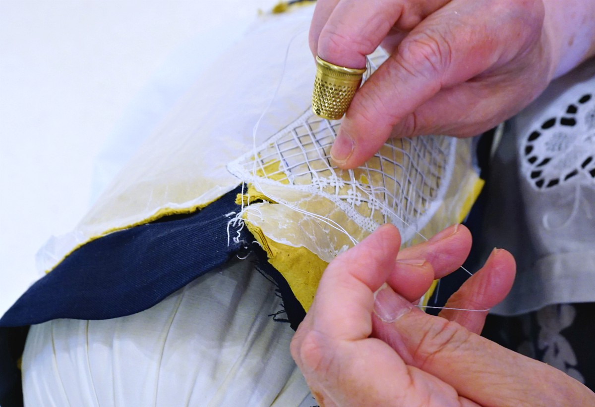 Lady embroidering