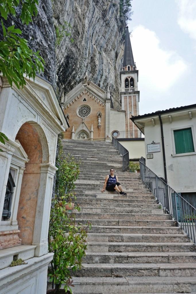 Me on the staircase of Madonna della Corona Sanctuary