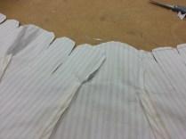 machine-sewn tabs