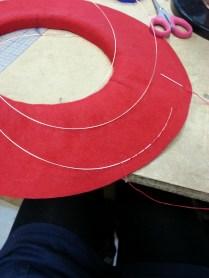 Blanket stitching wire to brim