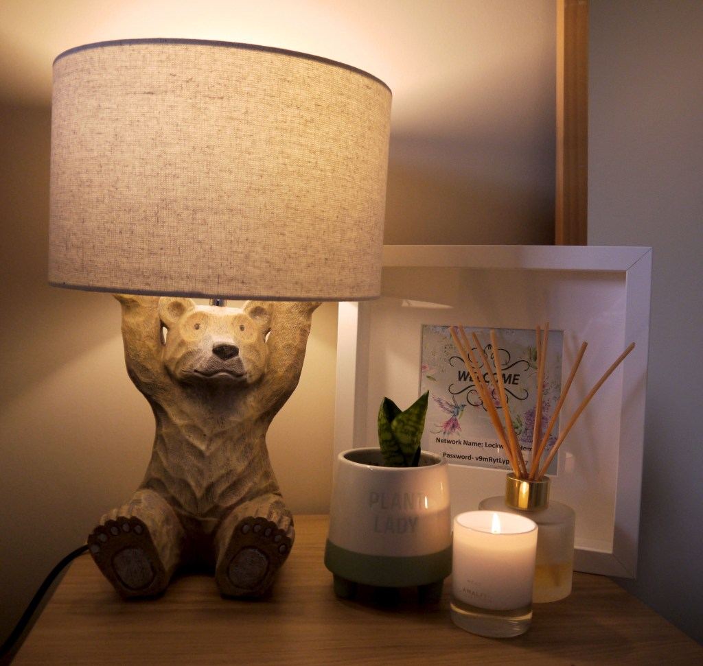 Bedside with the lamp and clutter items