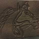 leather carved horse