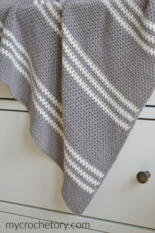 A simple and modern in its style Filip's Easy Crochet Blanket with an easy to follow moss stitch pattern. Free crochet pattern.