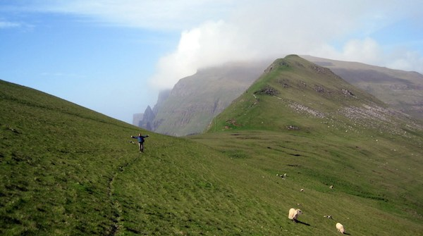 green hills and sea cliffs