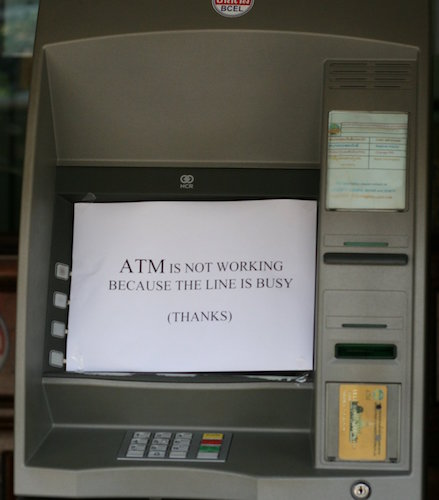 ATM with sign on it