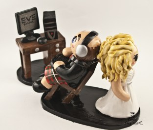 Bride Dragging Gaming Groom in Kilt Cake Topper