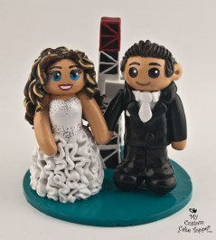 Bride and Groom in front of Derek's Hand Cake Topper