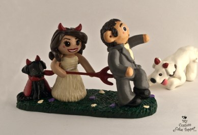 "Bride ""Devil Woman"" jabbing groom with pitch fork cake topper"