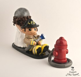 Army bride dragging her fireman groom cake topper