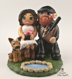 Bride and groom fishing at a pond cake topper