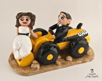 Bride And Groom Riding A Front Loader Cake Topper